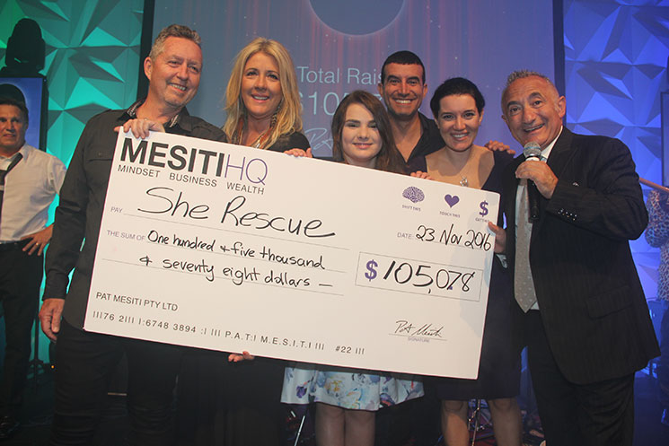 Leigh received a cheque at Pat Mesiti Event